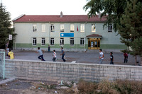 Kids Playing Soccer at the Local School